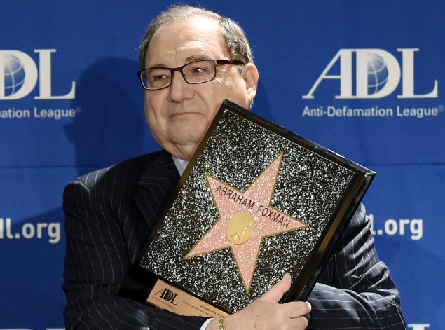 "Abraham Foxman holds a replica of the Hollywood Walk of Fame Star as he is honored at the ADL's Annual Meeting at The Beverly Hilton, November 07, 2014. Was it the Talmud or Peter Parker's uncle that said, ""With great power comes great responsibility.""(Kevork Djansezian/Getty Images)"