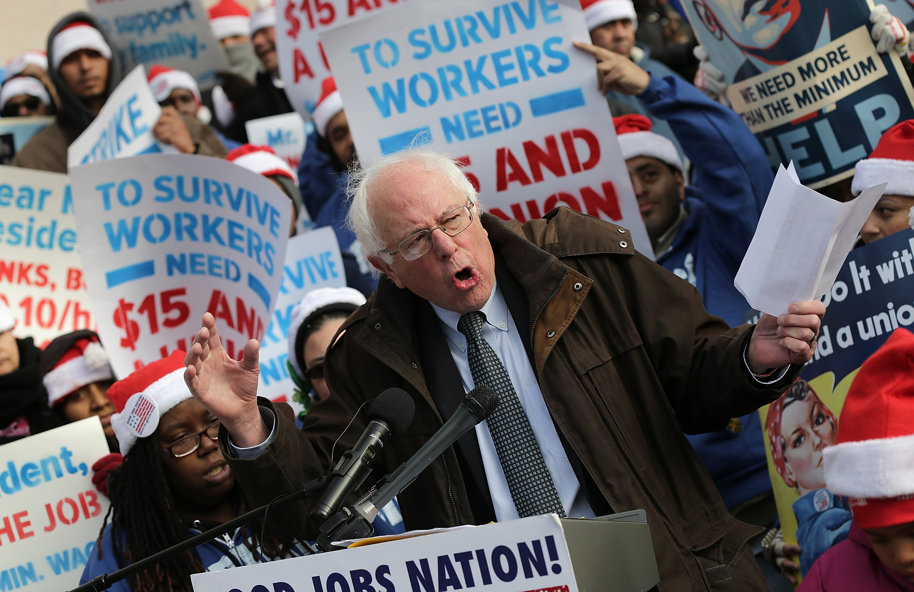 WASHINGTON, DC - DECEMBER 04:  U.S. Sen. Bernie Sanders (I-VT) speaks to low-wage federal contract workers during a protest where the workers demanded presidential action to win an increase to  $15 an hour wage December 4, 2014 in Washington, DC. A number of workers were expected to walk off their jobs later in the day as part of the protest.  (Photo by Win McNamee/Getty Images)