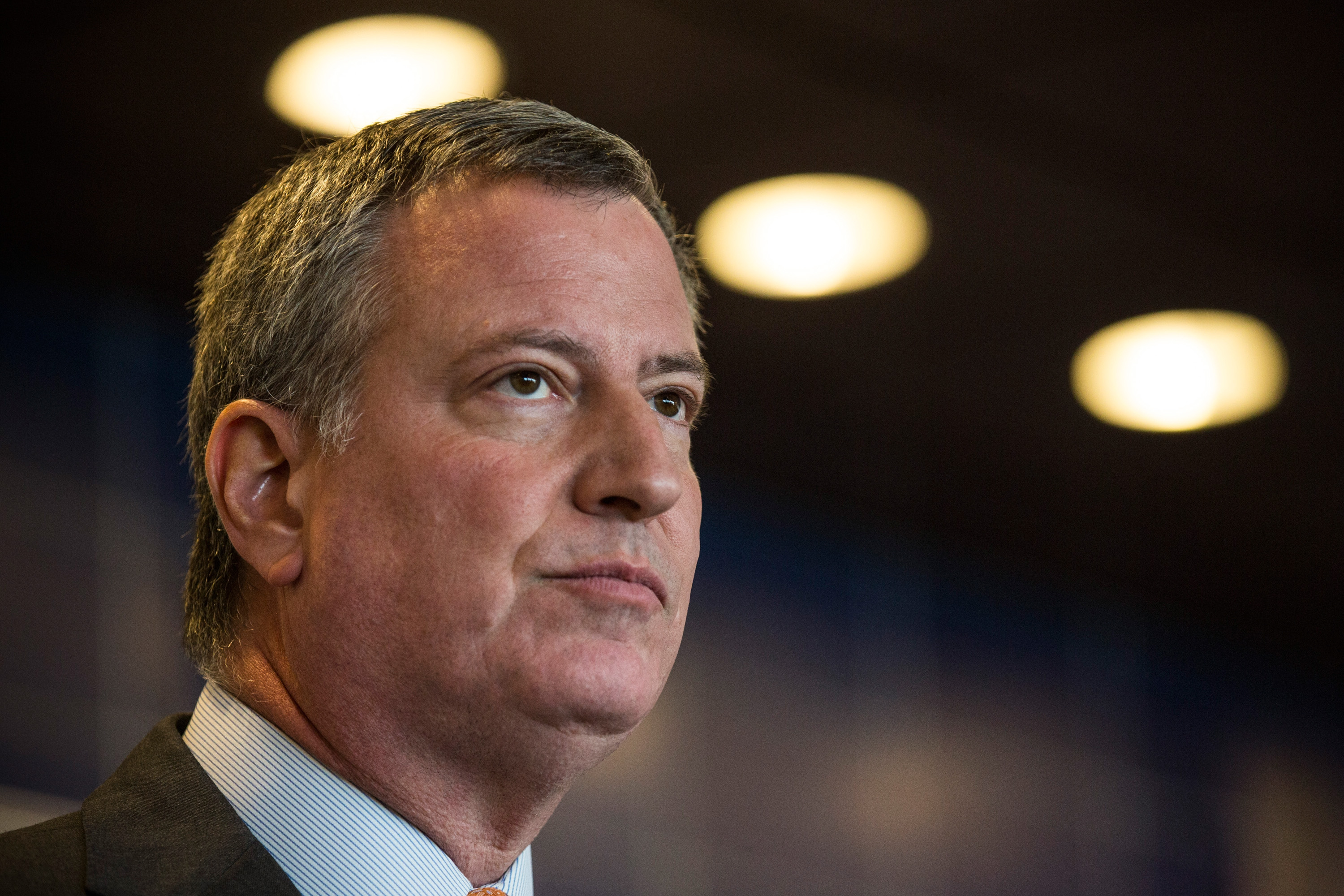 Bed-Stuy residents are asking Mayor Bill de Blasio to reconsider his opposition to a City Council plan to hire 1,000 new cops. (Andrew Burton/Getty Images)