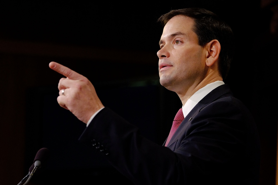 WASHINGTON, DC - DECEMBER 17:  Sen. Marco Rubio (R-FL) reacts to U.S. President Barack Obama's announcement about revising policies on U.S.-Cuba relations on December 17, 2014 in Washington, DC. Rubio called the President a bad negotiator and criticized what he claimed was a deal with no democratic advances for Cuba.  (Photo by T.J. Kirkpatrick/Getty Images)