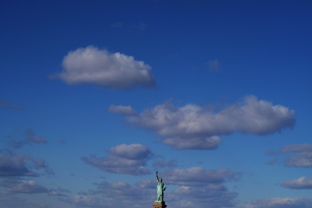 The Statue of Liberty is pictured from a passenger ferry in New York (Photo by  JEWEL SAMAD/AFP/Getty Images)