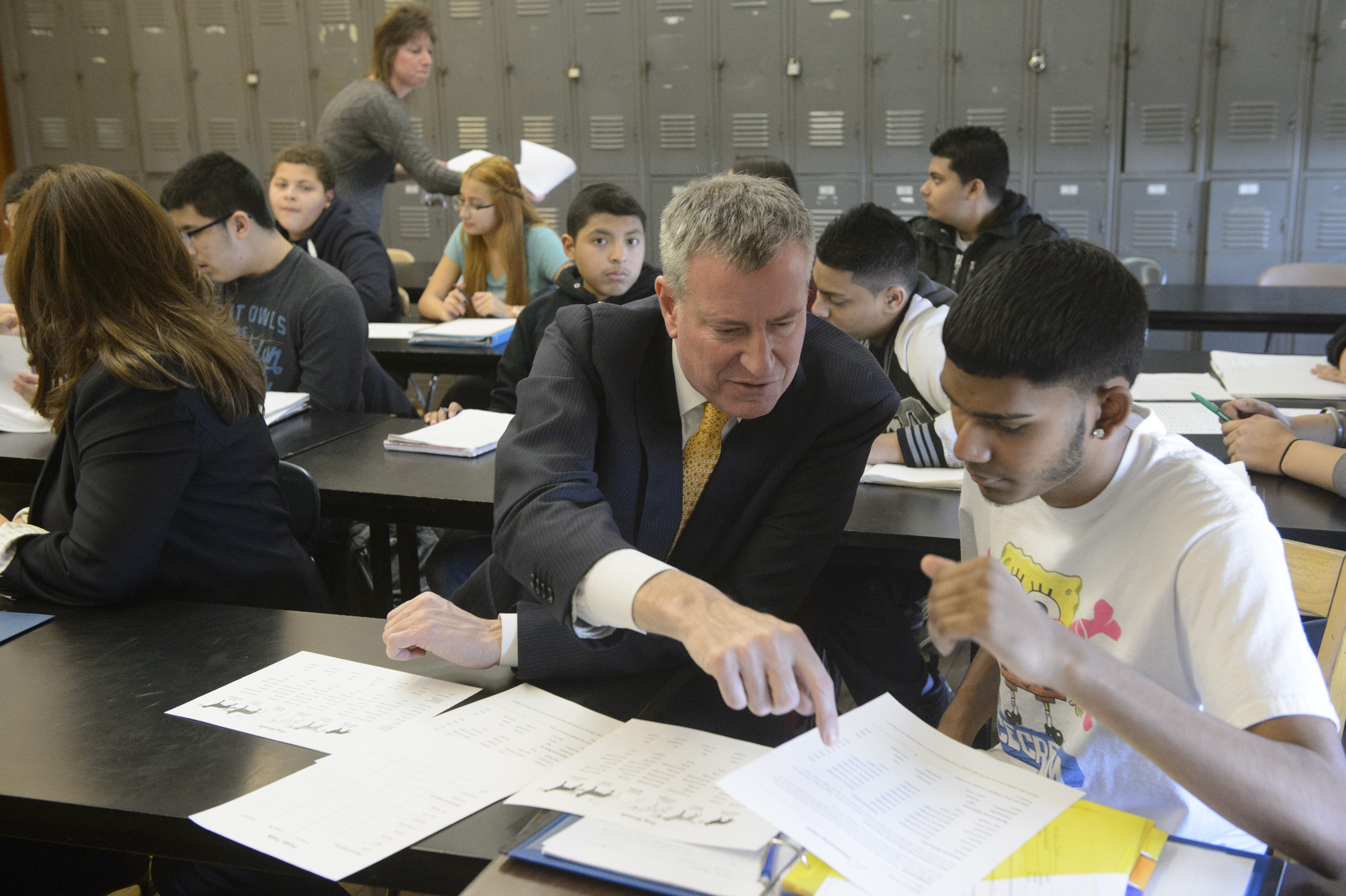 Mayor Bill de Blasio talks with a high school student (Photo: Charles Eckert-Pool for Getty Images)
