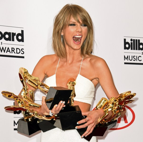 Taylor Swift poses in the press room iwth her awards at the 2015 Billboard Music Awards, May 17, 2015, at the MGM Grand Garden Arena in Las Vegas, Nevada..  AFP PHOTO / ROBYN BECK        (Photo credit should read ROBYN BECK/AFP/Getty Images)