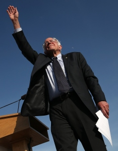 BURLINGTON, VT - MAY 26:  Democratic presidential candidate U.S. Sen. Bernie Sanders (I-VT) waves to supporters after officially announcing his candidacy for the U.S. presidency during an event at Waterfront Park May 26, 2015 in Burlington, Vermont. Sanders will run as a Democrat in the presidential election and is former Secretary of State Hillary Clinton's first challenger for the Democratic nomination.  (Photo by Win McNamee/Getty Images)