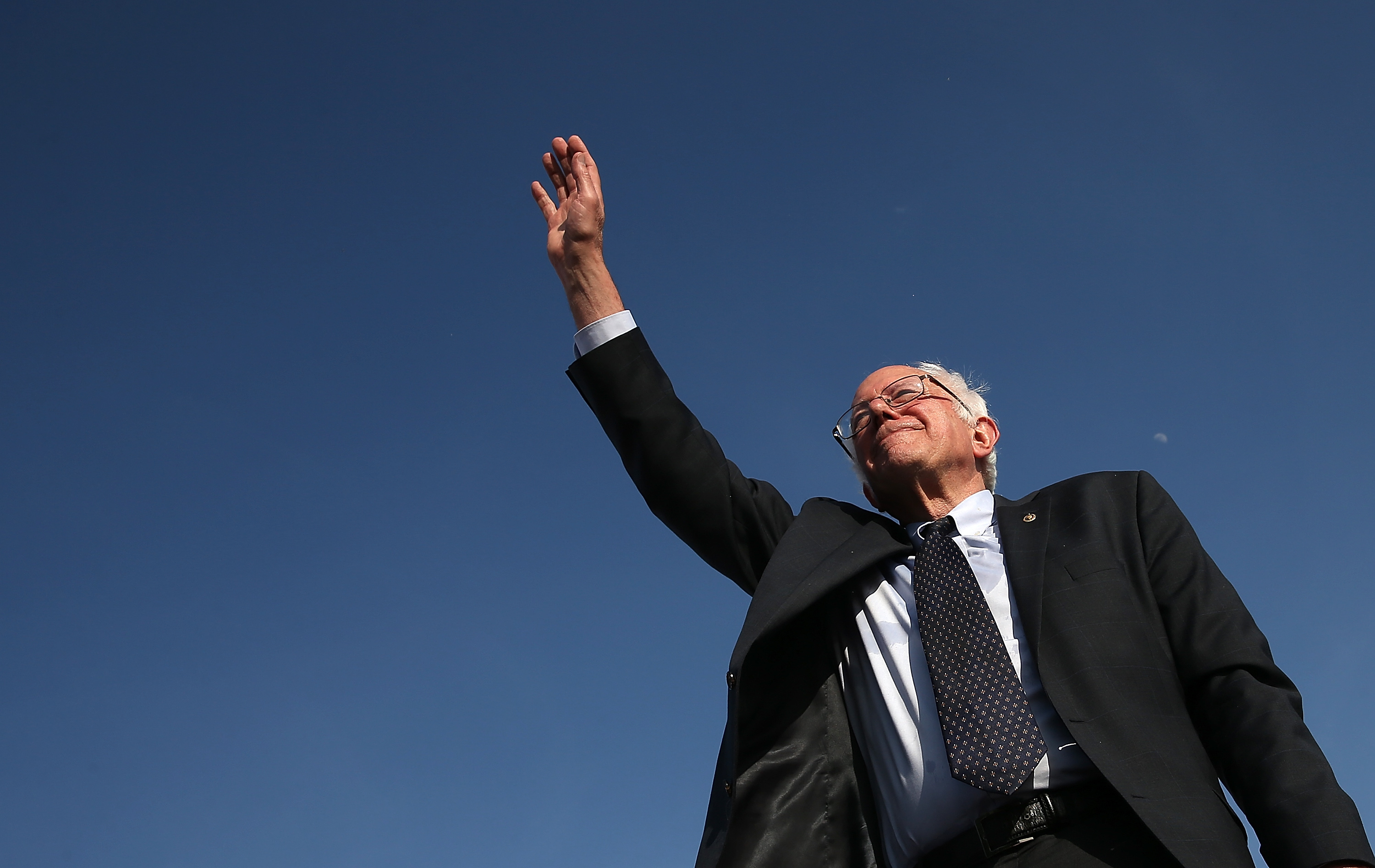 BURLINGTON, VT - MAY 26:  U.S. Sen. Bernie Sanders (I-VT) waves to supporters after officially announcing his candidacy for the U.S. presidency during an event at Waterfront Park May 26, 2015 in Burlington, Vermont. Sanders will run as a Democrat in the presidential election and is former Secretary of State Hillary ClintonÕs first challenger for the Democratic nomination.  (Photo by Win McNamee/Getty Images)