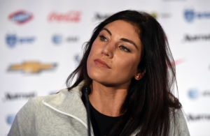 US Soccer team goalkeeper Hope Solo talks to the press during the US Women's National Team World Cup Media Day on May 27, in New York City. The FIFA Womens World Cup will be held in Canada, June 6 to July 5, 2015. AFP PHOTO / TIMOTHY A. CLARY
