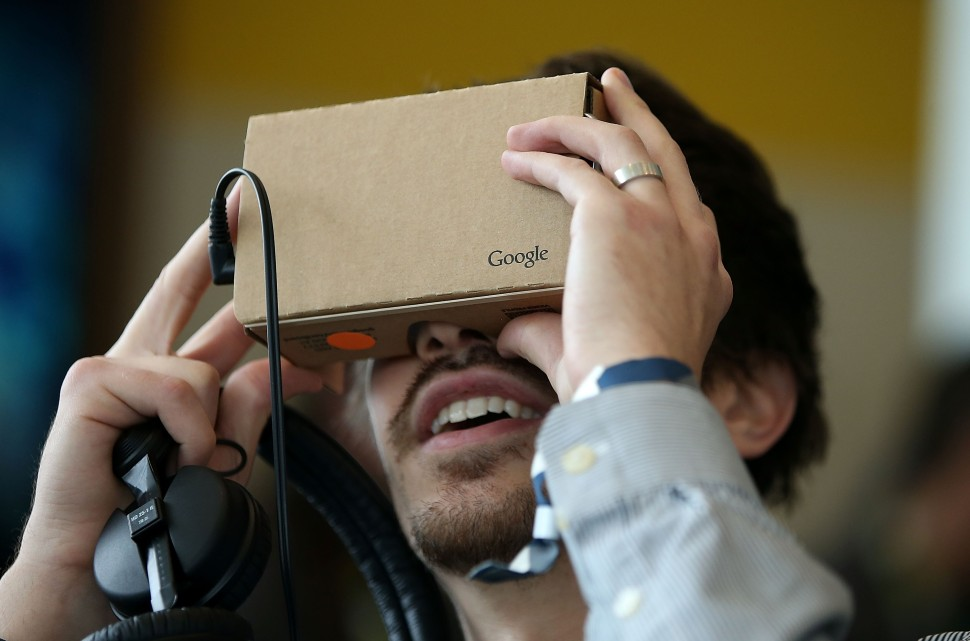 SAN FRANCISCO, CA - MAY 28:  An attendee inspects Google Cardboard during the 2015 Google I/O conference on May 28, 2015 in San Francisco, California. The annual Google I/O conference runs through May 29.