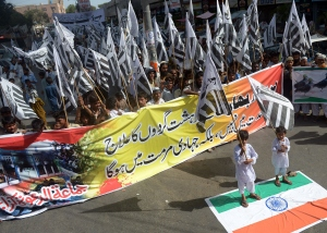 Pakistani activists from the banned organisation Jamaat-ud-Dawa (JuD) shout anti-Indian slogans during a protest in Karachi on June 12, 2015. Pakistan has strongly reacted to comments made by Indian Prime Minister Narendra Modi that reportedly acknowledged Indian troops had a role in the war that created Bangladesh which was part of Pakistan until 1971 when separtisits won independence after a war. Pakistani parliament on June 11, 2015, passed unanimous resolutions strongly condemning recent provocative statements made by Indian leaders, including the threat of attacks against Pakistani territory. AFP PHOTO / RIZWAN TABASSUM (Photo credit should read RIZWAN TABASSUM/AFP/Getty Images)