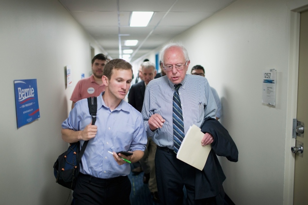 DES MOINES, IA - JUNE 13: Democratic Presidential candidate and U.S. Sen. Bernie Sanders (I-VT) (R) chats with a reprter during a visit to his Iowa campaign headquarters on June 13, 2015 in Des Moines, Iowa. Sanders began a three-day campaign trip to Iowa yesterday with a visit to Drake University where he was greeted by a standing-room-only crowd at Sheslow Auditorium. (Photo by Scott Olson/Getty Images)