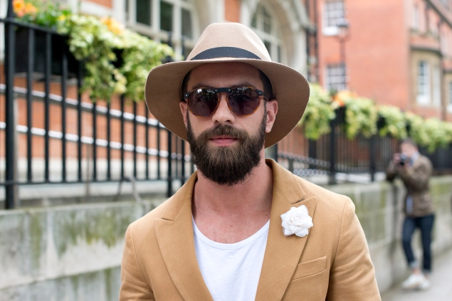 LONDON, ENGLAND - JUNE 13:Businessman Raphael Roche wears Topman hat, Gant jacket and sunglasses, Coach bag on day 2 of London Collections: Men on June 13, 2015 in London, England.  (Photo by Kirstin Sinclair/Getty Images)