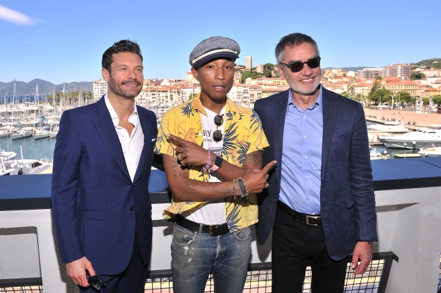 CANNES, FRANCE - JUNE 23: Ryan Seacrest, Pharrell Williams and Bob Pittman, Chairman and CEO of iHeartMedia Inc pose on the balcony of the Palais des Festivals after the iHeart Seminar during the Cannes Lions International Festival of Creativity on June 23, 2015 in Cannes, France.  (Photo by Francois G. Durand/Getty Images)