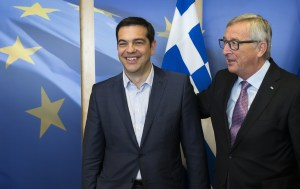 Greece's Prime Minister Alexis Tsipras (L) is welcomed by European Commission President Jean-Claude Juncker (R) ahead of a meeting on Greece, at the European Commission in Brussels, on June 24, 2015, as eurozone finance ministers try to finalise a debt deal and avoid a default by Athens. Greek Prime Minister Alexis Tsipras is set to conduct yet another round of crisis talks with representatives of the country's creditors, ahead of a crucial meeting of eurozone finance ministers where all sides hope a solution can be found to save the country from bankruptcy. AFP PHOTO / POOL / JULIEN WARNAND (Photo credit should read JULIEN WARNAND/AFP/Getty Images)