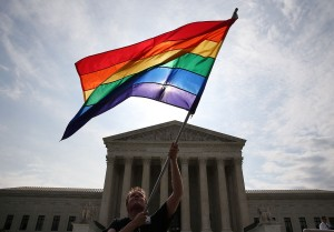 WASHINGTON, DC - JUNE 25: A gay marriage supporter waves a flag in front of the Supreme Court Building in Washington, D.C. (Photo: Mark Wilson/Getty Images)