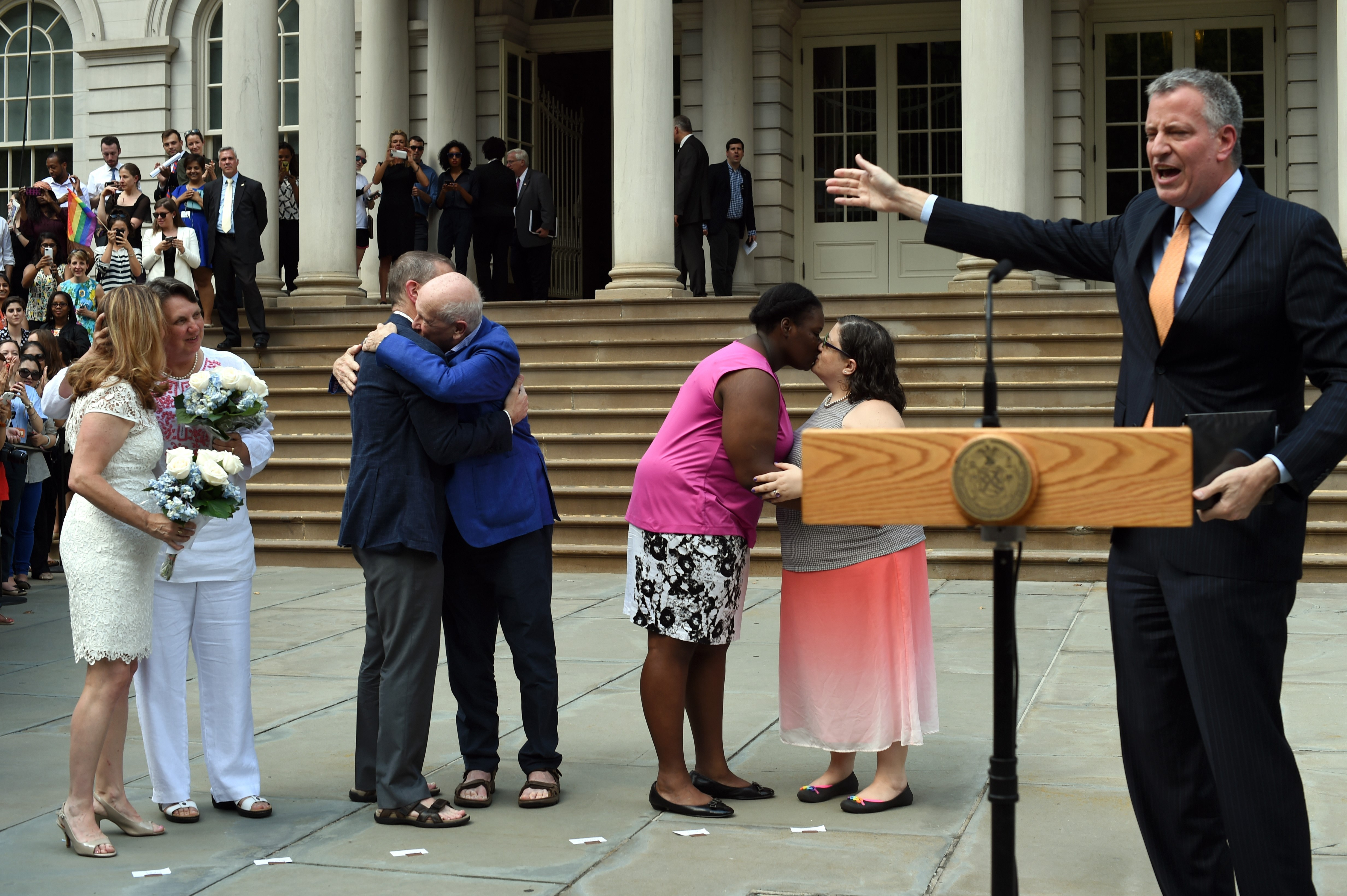New York City Mayor Bill de Blasio officiates the marriages of Denise Niewinski and Cindy Jackson, Terrence McNally and Thomas Kirdahy and Sarah Joseph and Katrina Council on the steps of City Hall (Photo: TIMOTHY A. CLARY/AFP/Getty Images)