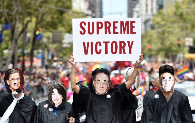 People dressed as United States Supreme Court Justices march along Market Street during the annual Gay Pride Parade in San Francisco, California on June 28, 2015, two days after the US Supreme Court's landmark ruling legalizing same-sex marriage nationwide. (read Josh Edelson/AFP/Getty Images)