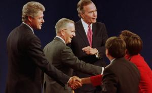EAST LANSING, MI - OCTOBER 19: Michigan: U.S. presidential candidates Bill Clinton (L), Ross Perot (C) and President George Bush (R) shake hands with the panelists after the conclusion of their final debate 19 October 1992. Two weeks are left in the presidential campaign. (Photo credit should read J. DAVID AKE/AFP/Getty Images)