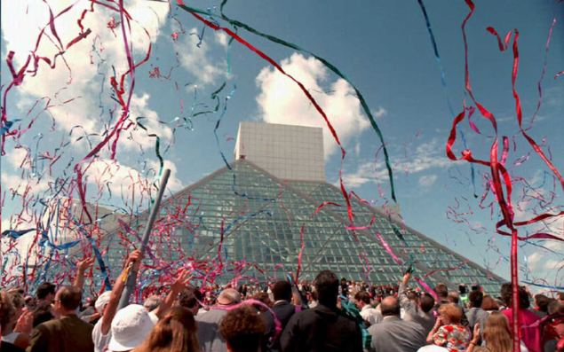 CLEVELAND, OH - SEPTEMBER 1: Streamers fill the sky over the Rock and Roll Hall of Fame and Museum 01 September after the opening ceremony. Between 20,000 and 30,000 people attended the ceremonies and parade that accompanied the opening of the museum designed by I.M. Pei. AFP PHOTO (Photo credit should read KIMBERLY BARTH/AFP/Getty Images)