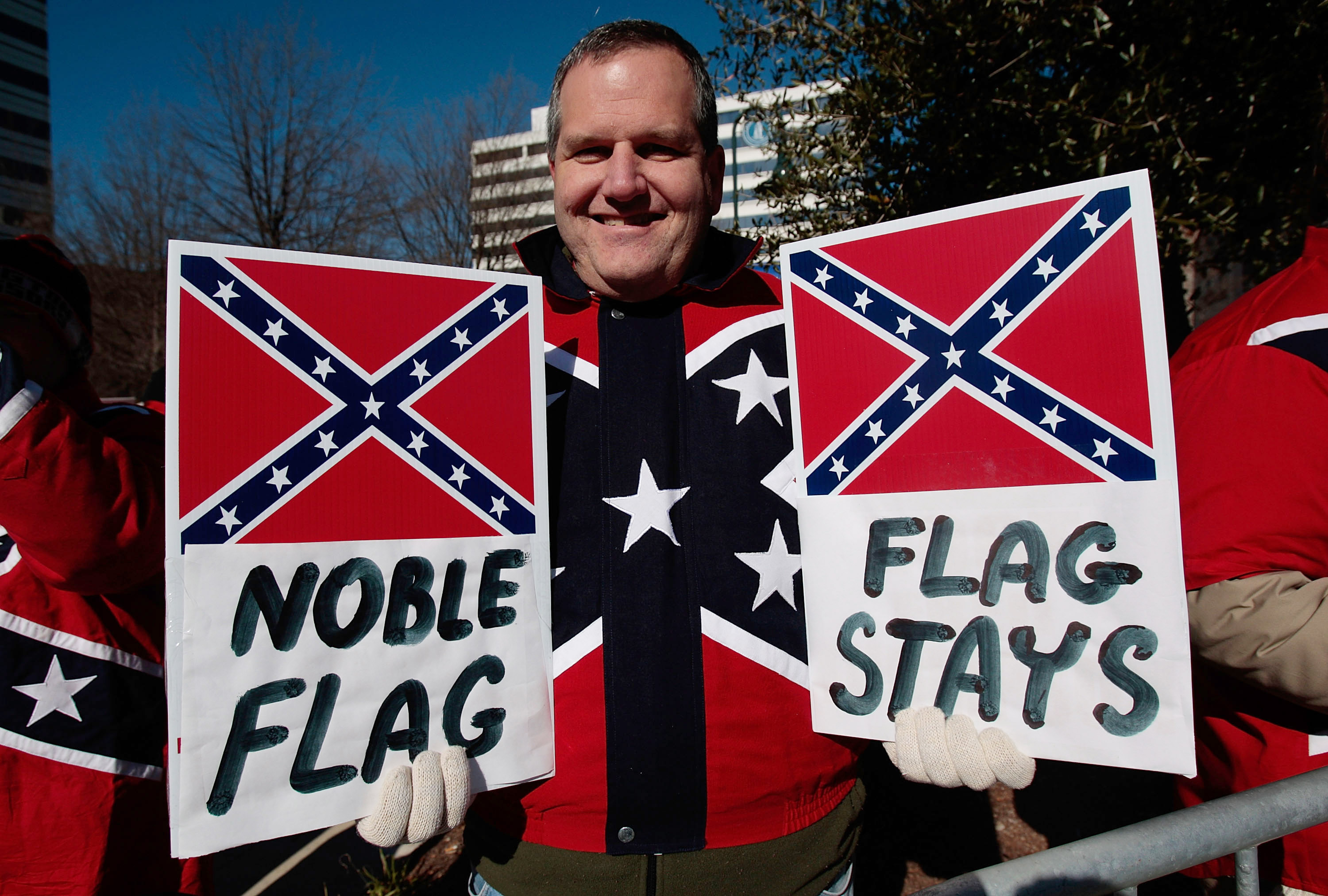 COLUMBIA, SC - JANUARY 21:  Dr. John Cobin of Greenville, South Carolina displays signs in support of displaying the Confederate flag at a Martin Luther King Day rally January 21, 2008 in Columbia, South Carolina. (Chris Hondros/Getty Images)