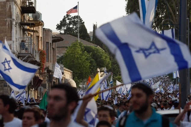 Israelis dance with their national flags as they fill the street in Jerusalem, Israel.(Photo by David Silverman/Getty Images)