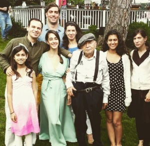Joe surrounded by family in 2013. The author is at the back.