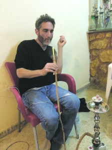 Author smoking shisha at bar mentioned in story. (Photo: Ken Silverstein)
