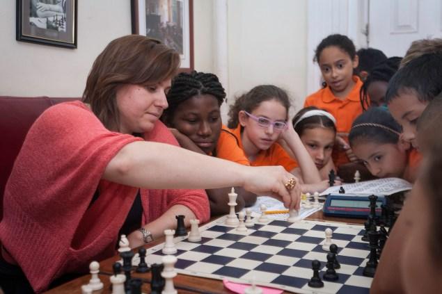 Grandmaster Judit Polar with Success Academy chess scholars at the Marshall Club. (Photo by Ari Mintz)