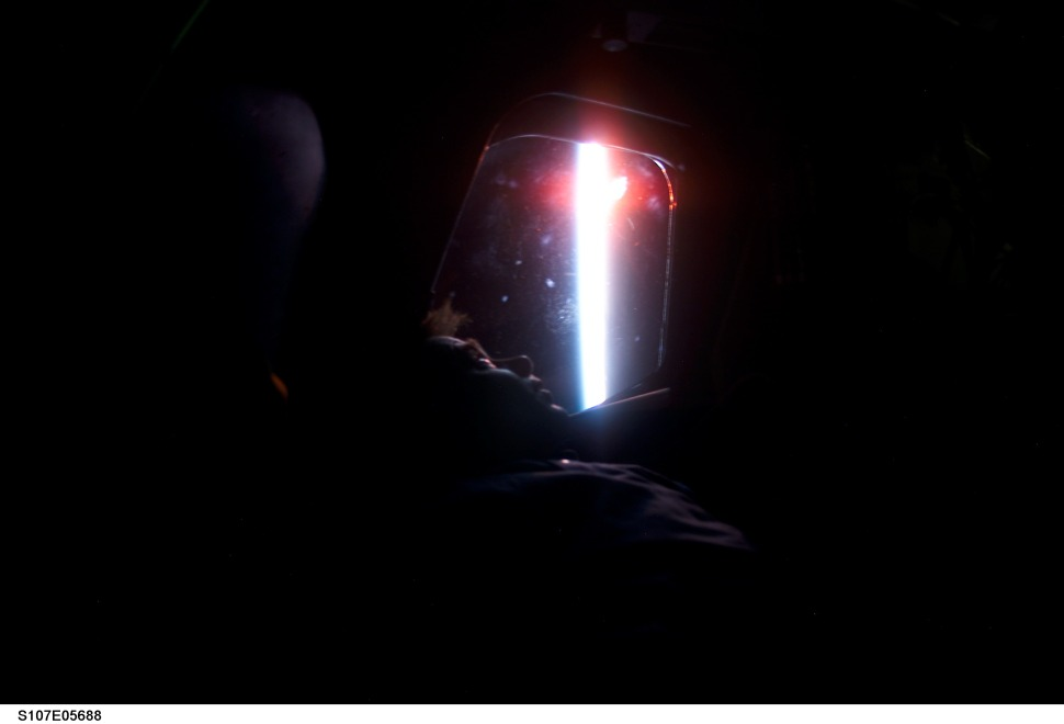 STS107-E-05688 (26 January 2003) --- Ilan Ramon, STS-107 payload specialist, looks at Earth's horizon through a window of the Space Shuttle Columbia. Ramon represents the Israeli Space Agency.