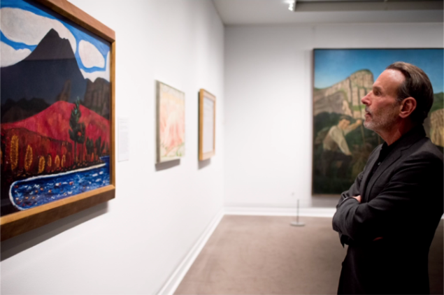 David Salle examining a painting by Marsden Hartley