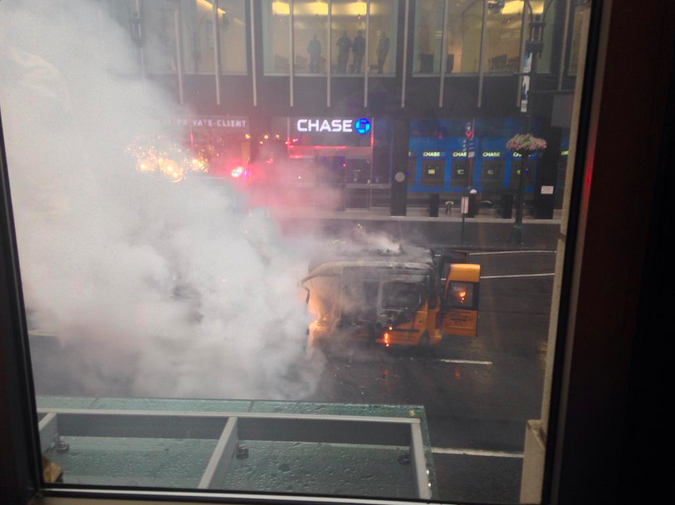 Taxi burning up in Midtown
