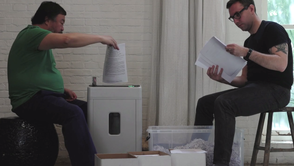 Artist Ai Weiwei and activist Jacob Applebaum shreadding NSA documents. (Image: Film still courtesy Praxis Films)