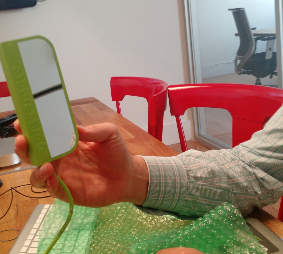 Placemeter CEO Alexandre Winter shows the prototype sensor. (Photo: Brady Dale/Observer)