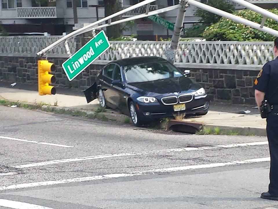Mark J. Semeraro's 5-series Bimmer was smashed by a driver who blew a red light, yards from the entrance to the George Washington Bridge.