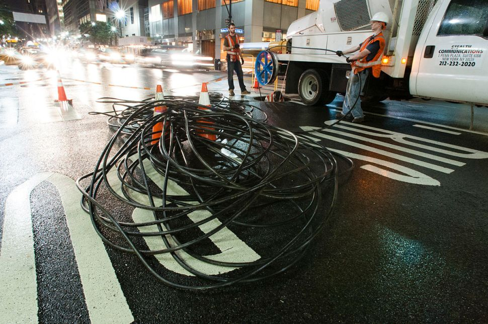 Stealth Fiber Crew installing fiber optics. Stealth is one of the company's in today's announcement, connecting Southwest Brooklyn. [Photo: Shuli Hallak, Creative Commons]