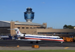 An American Airlines jet taxis on the runway of LaGuardia. (Photo by Bruce Bennett/Getty Images)