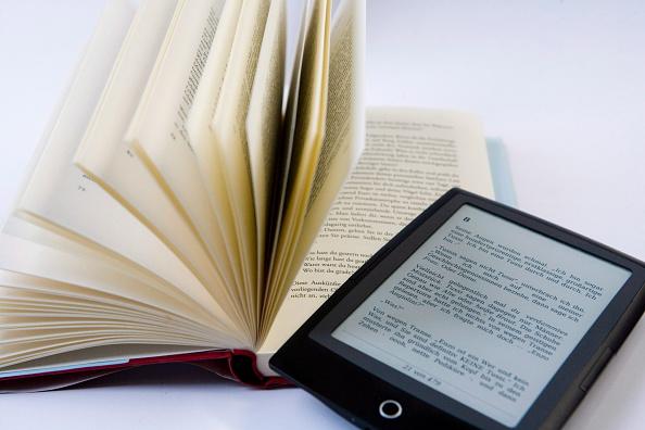Bound Book vs. E-book (Photo by Ulrich Baumgarten via Getty Images)