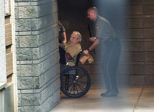Robert Gentile is brought into the federal courthouse in a wheelchair on Monday, April 20, 2015, for a continuation of a hearing that was held Friday after Gentile was arrested after selling a gun to an undercover agent. (Cloe Poisson/Hartford Courant/TNS via Getty Images)
