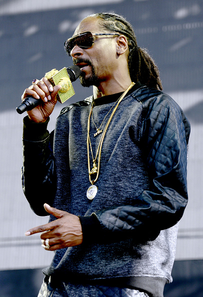 Snoop Dogg shows off his pony tail (Photo by Tim Mosenfelder/Getty Images)