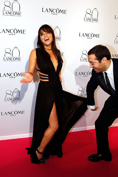 Actress Michelle Rodriguez and Mohammed Al Turki have a little fun as they arrive (Photo by Bertrand Rindoff Petroff/Getty Images)