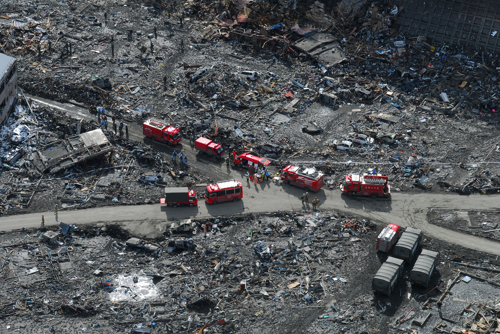 An aerial view of Japanese Ground Self-Defense Force personnel and disaster relief crews searching Sukuiso, Japan for victims of a 9.0-magnitude earthquake and subsequent tsunami. (U.S. Navy photo by Mass Communication Specialist 3rd Class Dylan McCord/Released)