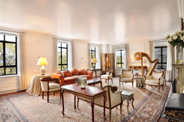The living room at 145 Central Park West, complete with a harp and some type of doll-figure. (Street Easy)