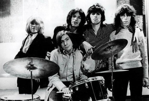 1960's, British pop group The Rolling Stones pose for a group portrait, They are L-R: Brian Jones, Charlie Watts (on drums), lead singer Mick Jagger, Keith Richards and Bill Wyman  (Photo: Courtesy of by Popperfoto/Getty Images)