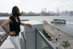 Maria Makres waits for a Manhattan-bound ferry from the terrace of her building in Williamsburg. Photo: Aaron Adler for the Observer