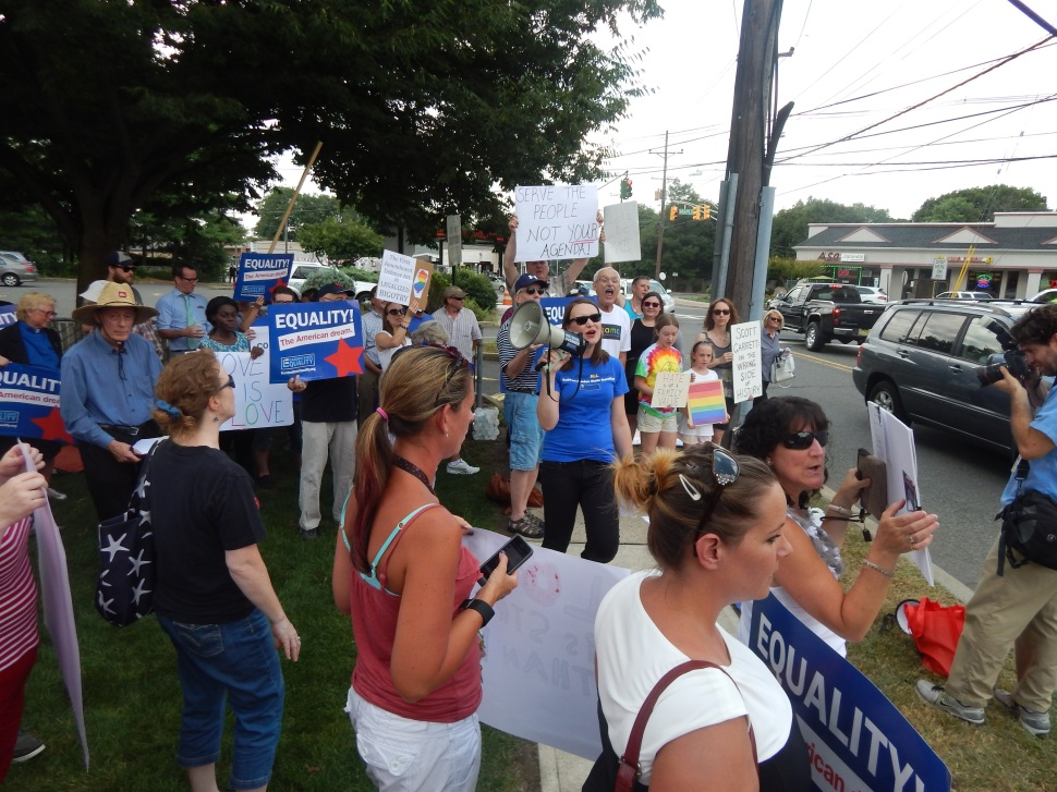 """""""Hey hey, ho ho, Scotty G has got to go!"""" Gay rights activists stampeded Garrett's district office last week."""
