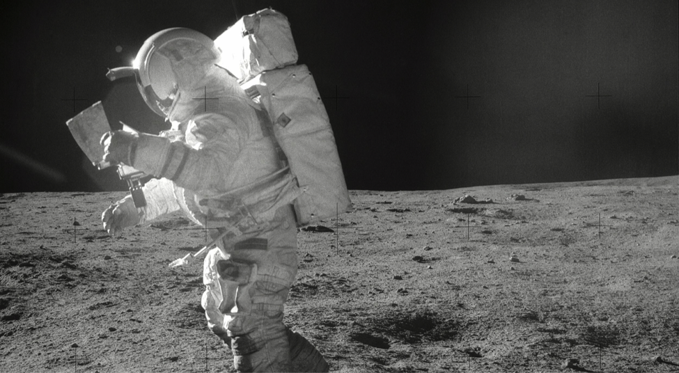 Astronaut Edgar Mitchell walks on the Moon during the Apollo 14 mission.