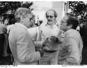 Bill Gaddis, E.L. Doctorow and Sidney Lumet photographed by Jill Krementz on July 9, 1983 at a party in Sag Harbor hosted by the Doctorows.  Helen Doctorow is visible in the background, just behind Gaddis.