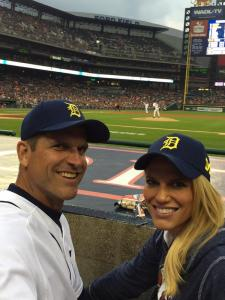 Jim and Sarah Harbaugh wearing maize and blue Tigers hats. (Twitter/@coachjim4um )