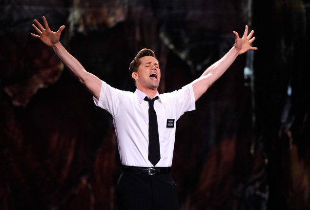 """NEW YORK, NY - JUNE 12:  Andrew Rannells and the cast of """"The Book of Mormon"""" performs on stage during the 65th Annual Tony Awards at the Beacon Theatre on June 12, 2011 in New York City.  (Photo by Andrew H. Walker/Getty Images)"""