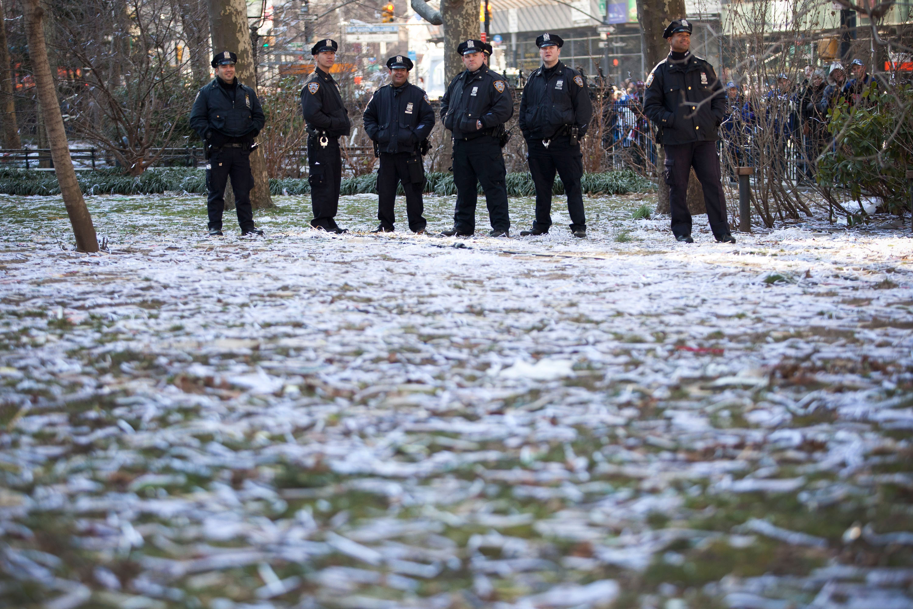 Police stand amongst a field of ticker tape after a parade for the New York Giants in 2012.  (Photo by Andrew Burton/Getty Images)