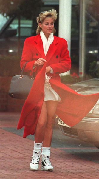 White sneakers under a long red peacoat? Why not? (Photo credit should read GERRY PENNY/AFP/Getty Images)