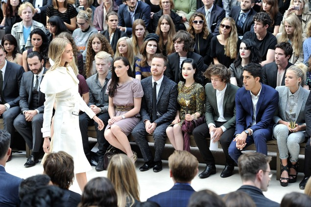 Ms. Wilde (at far right) and Mr. Styles (third from right) in the front row of a 2012 Burberry runway show.  (Photo: Gareth Cattermole/Getty Images for Burberry)